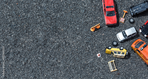 Top view of cars (miniature, toy model ) accident on street.Insurance concept.
