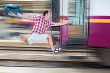 Tourist With Bag Running Behin...