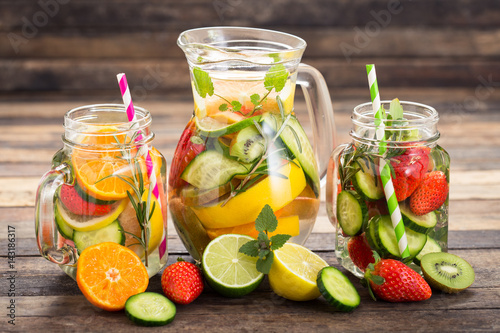 Fényképezés Fresh detox water with fresh fruits, vegetables and herbs
