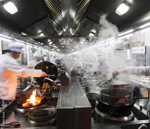 Fototapeta Motion chefs in a Chinese restaurant kitchen. obraz