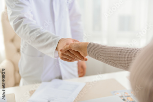 Female thanking doctor for good health Canvas Print