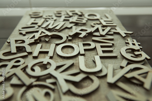Fényképezés  Hope spelled out in wood letters