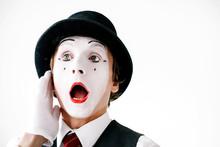 Mime In Black Hat Hears Something