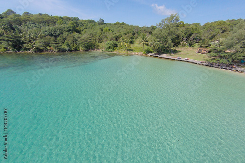 Staande foto Eiland Aerial view of a tropical island in turquoise water. Luxurious over-water villas on tropical Kood island, for holiday vacation background concept -Boost up color Processing.