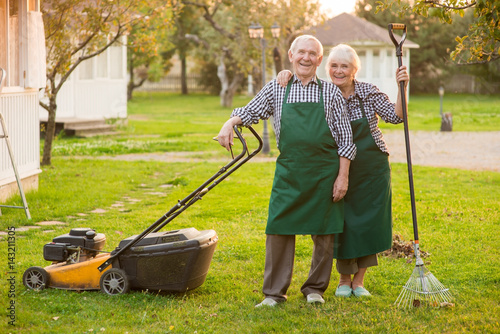 Smiling couple of senior gardeners  Happy people outdoors, summer