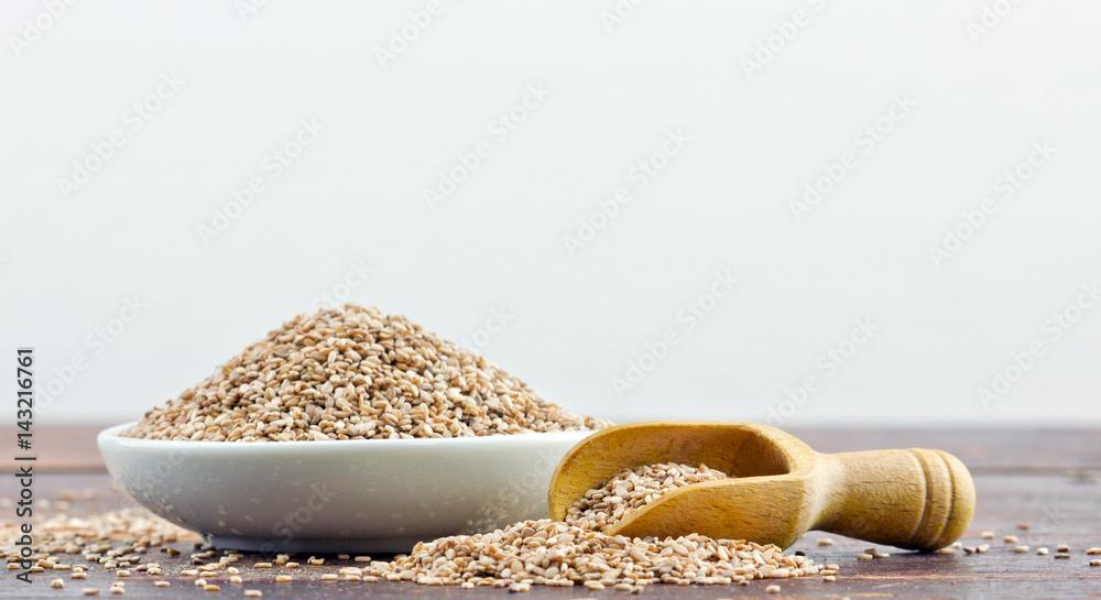 Fototapety, obrazy: sesame seeds / Porcelain dish with sesame seeds