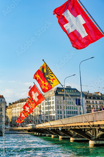Mont Blanc bridge and Swiss flags above Geneva Lake Geneva Canvas Print