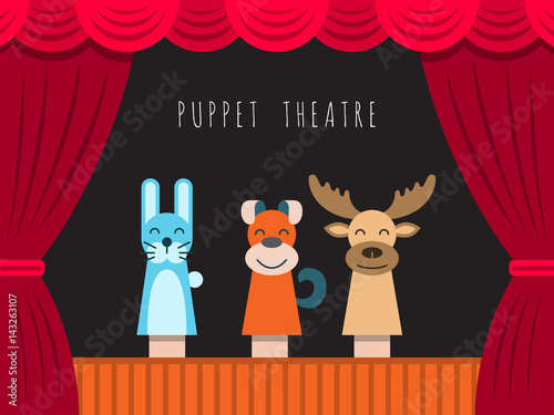 Fotografie, Obraz Childrens performance in the puppet theater at the theater with price, curtain and scenery