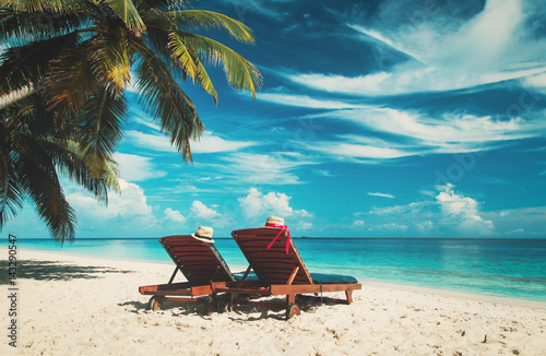 Fotografia Two chairs on the tropical beach