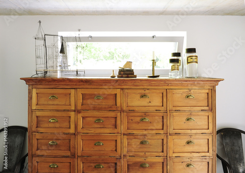 Chest of drawers or buffet in antique wood with objects of flea market and decoration