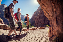 Hikers Moving Forward On The Stone Path In The Bryce Canyon, USA