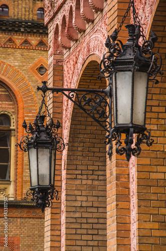 Staande foto Praag Black old vintage lamps on brick wall in old town castle