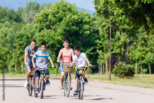 Fotografie, Obraz  Family of four on bike tour in summer