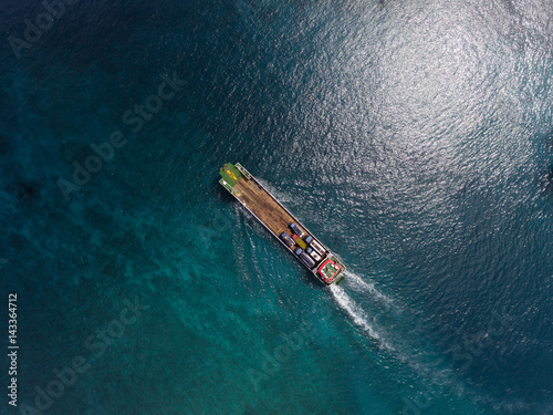 Valokuva  Aerial shot of the cargo moving in the sea