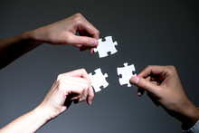 Hands Holding Jigsaw Puzzles, ...