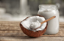 Fresh Coconut Oil On Wooden Ta...
