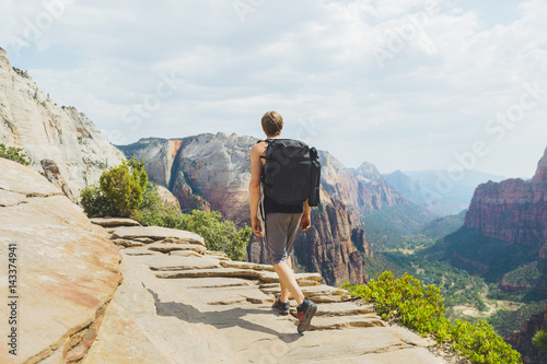 USA, Utah, Man hiking in Zion National Park