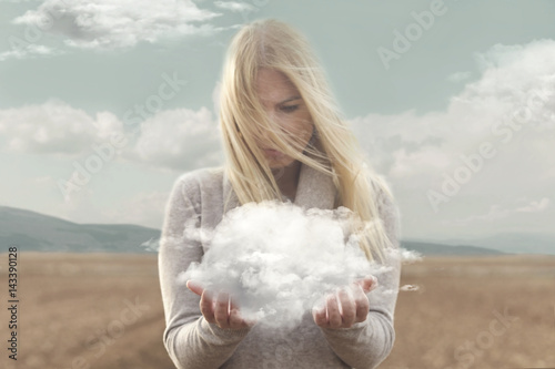Cuadros en Lienzo surreal moment , woman holding in her hands a soft cloud