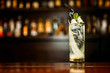 canvas print picture - ocktail with cucumber on a bar counter in a night club