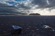 Icelandic landscape with black stone ground