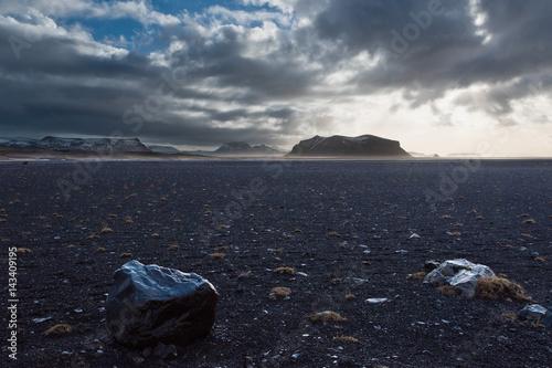 Foto op Aluminium Nachtblauw Icelandic landscape with black stone ground