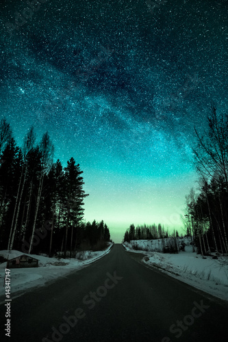 Photo  Night sky with weak aurora borealis by a road