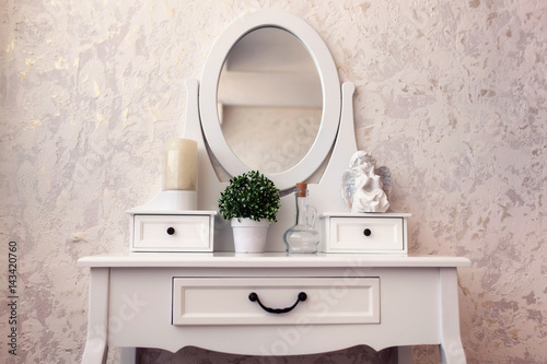 Beautiful wooden dressing table with mirror on white background wallpaper Fototapet