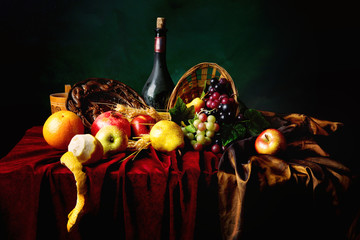 FototapetaClassic Dutch still life with dusty bottle of wine and fruits on a dark green background, horizontal