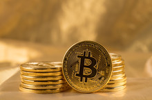 Stack Of Bitcoins With Gold Background