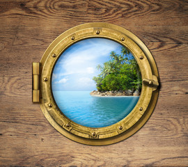 Fototapeta Marynistyczny boat window or porthole with tropical island