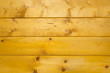 Abstract texture of treated, stained and polished wood with natural spots, scars and marks