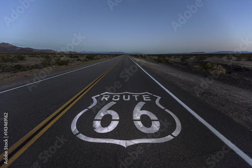 Poster Route 66 Route 66 pavement sign and desert dusk near Amboy California.