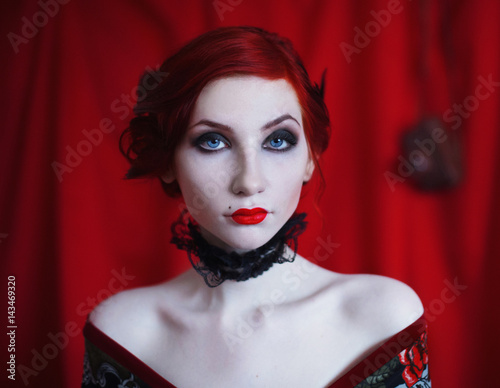 A Woman With Red Curly Hair In A Black Dress And Retro