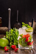 Motokhito with tequila, liqueur peach, sugar syrup, soda, strawberry, a lime, mint with ice
