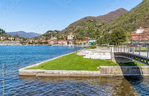 Foto auf Gartenposter Stadt am Wasser View of Laveno Mombello, is the tourism capital of the eastern shore of Lake Maggiore in province of Varese, Italy