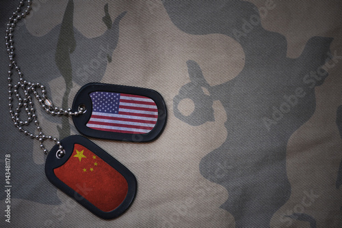 Fotografie, Tablou  army blank, dog tag with flag of united states of america and china on the khaki texture background