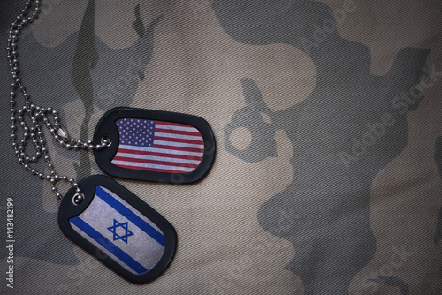 Fotografie, Tablou  army blank, dog tag with flag of united states of america and israel on the khaki texture background
