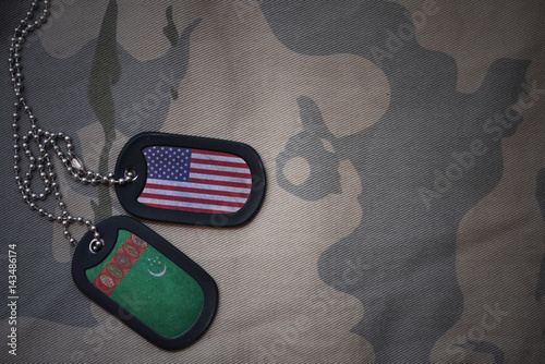 army blank, dog tag with flag of united states of america and turkmenistan on the khaki texture background Fototapet
