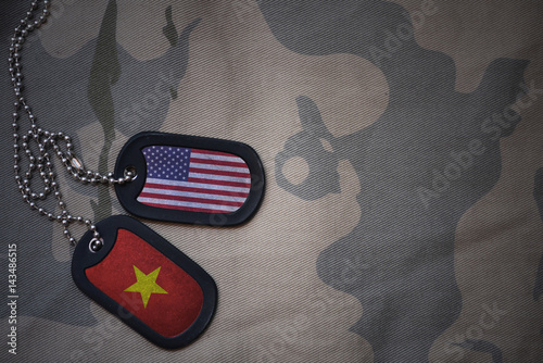 Fotografie, Tablou  army blank, dog tag with flag of united states of america and vietnam on the khaki texture background