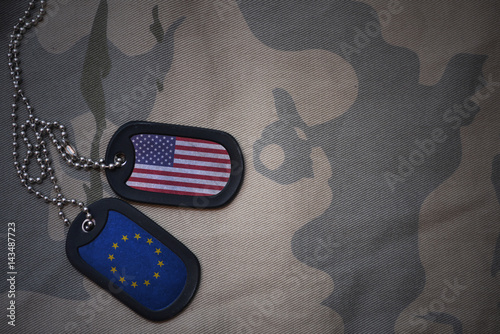 army blank, dog tag with flag of united states of america and european union on the khaki texture background Fototapet