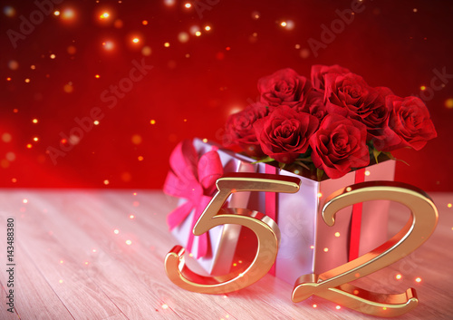 Fotografía  birthday concept with red roses in gift on wooden desk