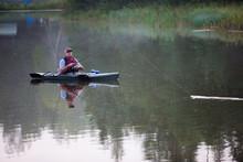 Middle Aged Man Kayak Fishing