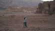 young woman walking in desert in the evening, after sunset. Timna Park, Israel