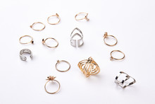 Many Different Rings On A White Background.