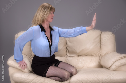 Valokuva  Woman using body language and palm of hand in a gesture of keep away