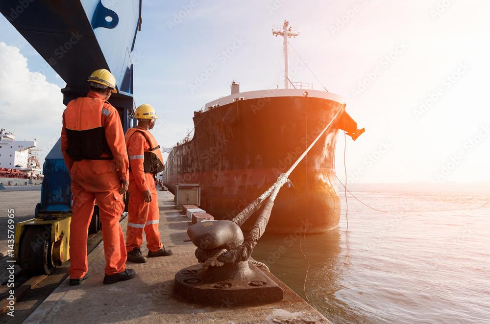 Fototapeta mooring gang in port to departure ship