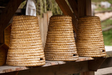 Three Old Beehives Of Straw