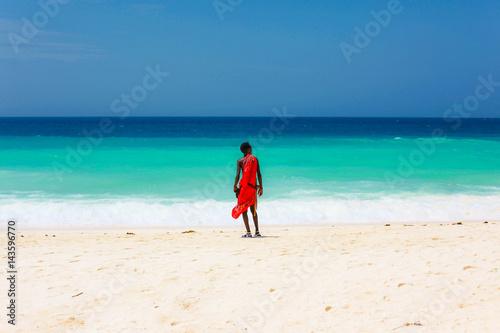 Poster Zanzibar masai on a beach and blue sea Zanzibar, Tanzania