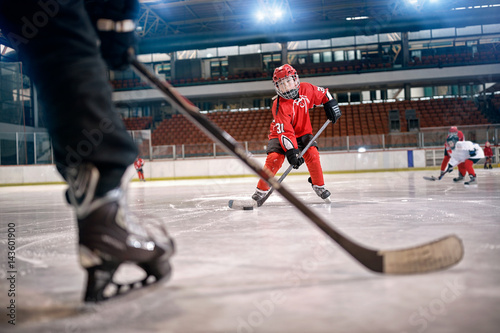 Hockey match at rink player in action .
