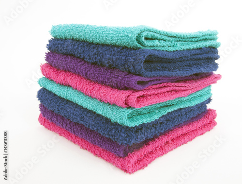 Fotomural Front and side view of stacked washcloths. Isolated.